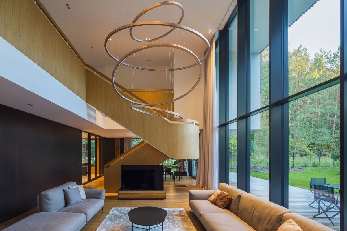 The staircase doubles as a space divider and has a stylish and eye-catching design