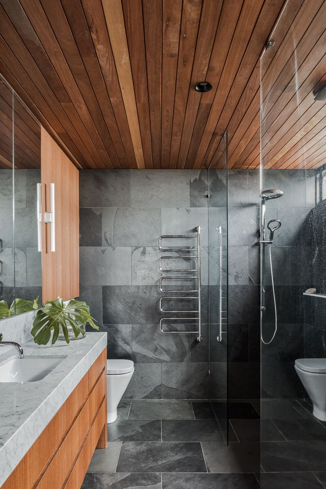 Wood was also used for the bathroom ceiling and it adds a really nice spa-like look to this space