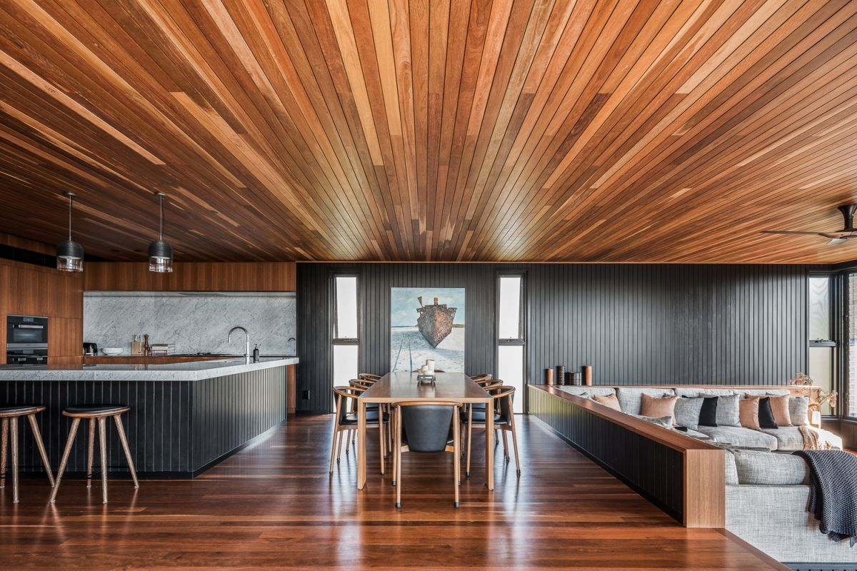 The wood-paneled floor, ceiling and walls create a very warm and welcoming ambiance inside the house