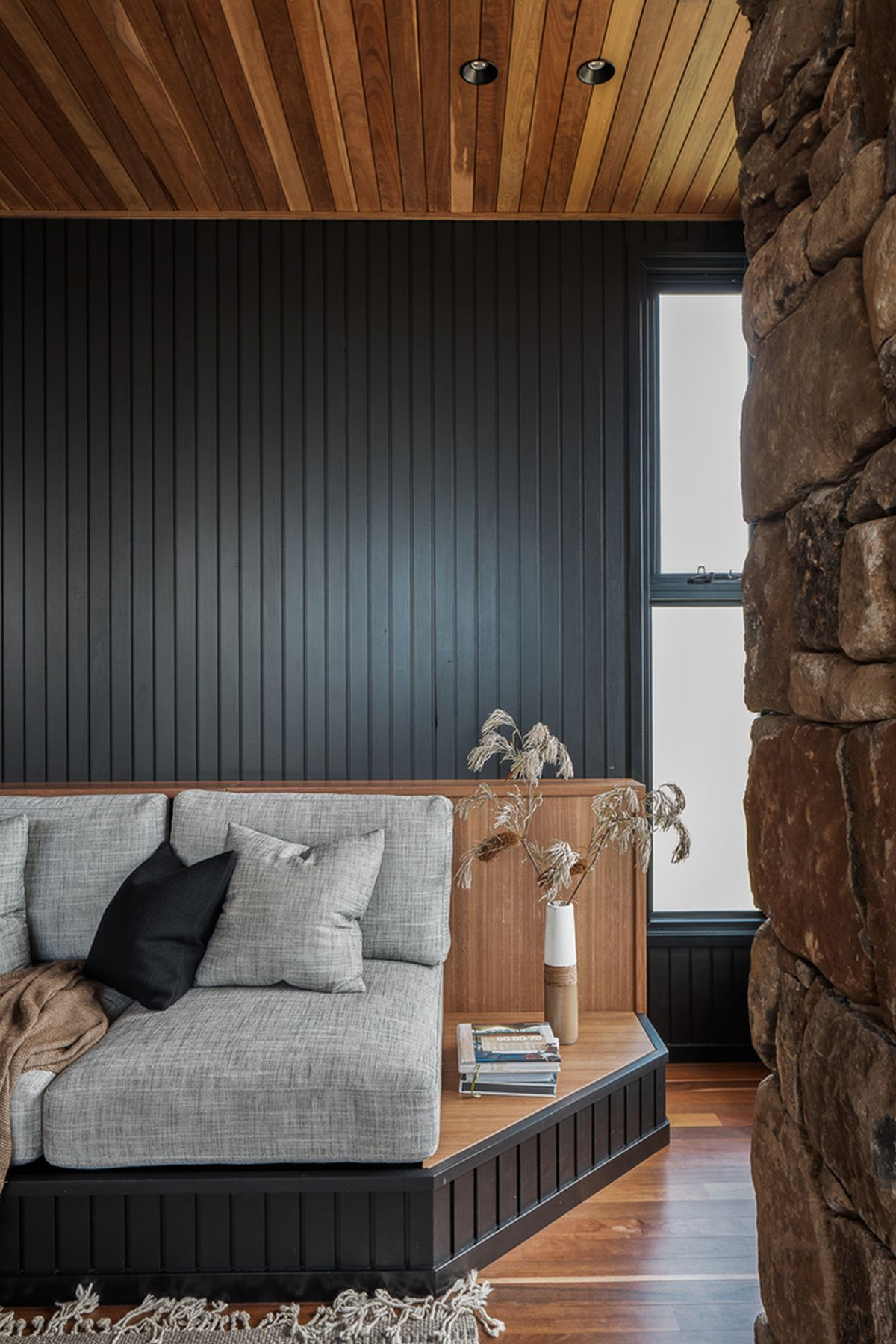The color palette employed throughout the house is defined by various dark tones