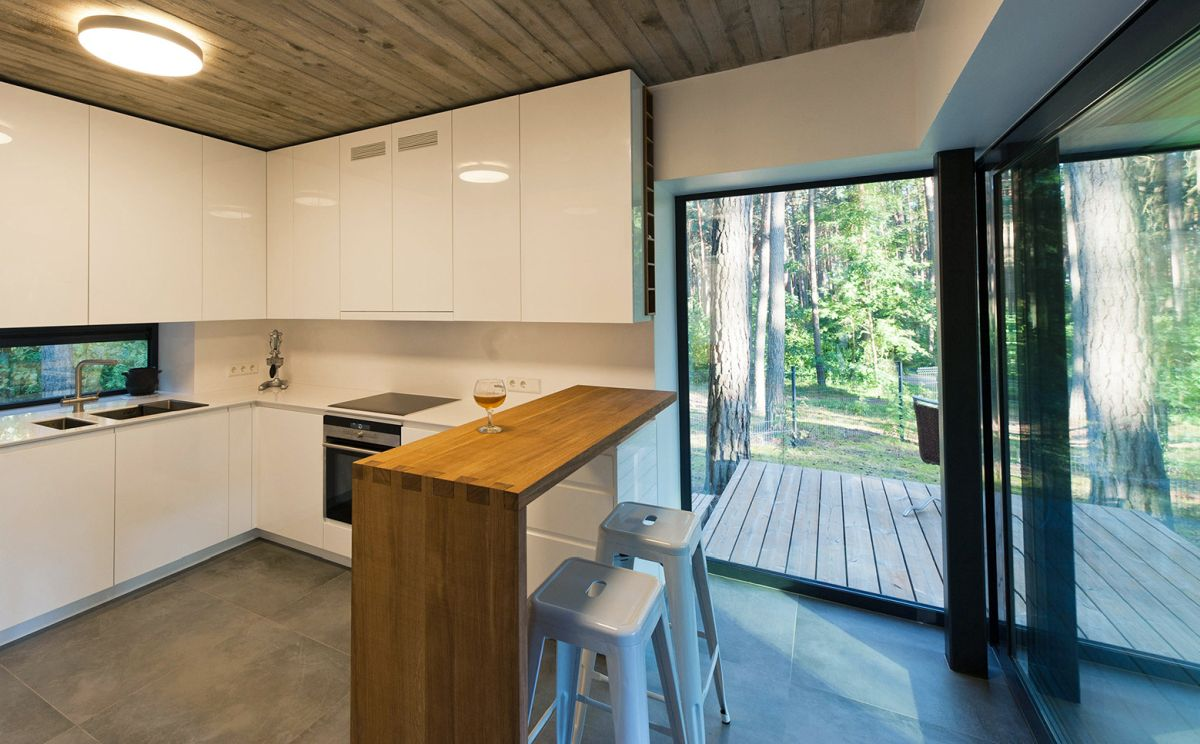The kitchen opens onto a large wooden deck and received lots of sunlight