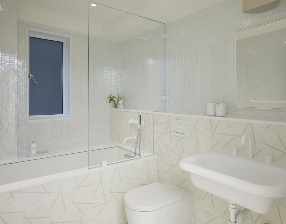 The geometric tile pattern brightens up this bathroom without making it look too busy