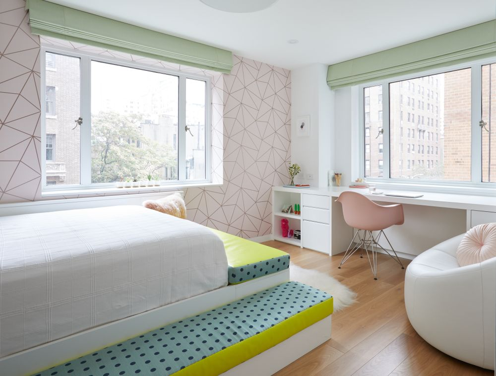 The daughter's bedroom is delightfully colorful and has a very stylish look