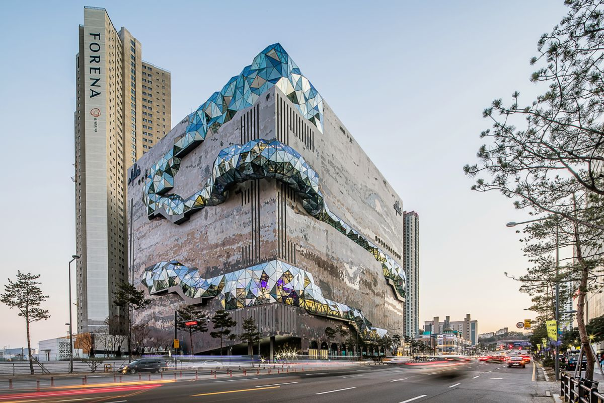 The glass sections resemble giant gems growing out of the building and spreading across the facades