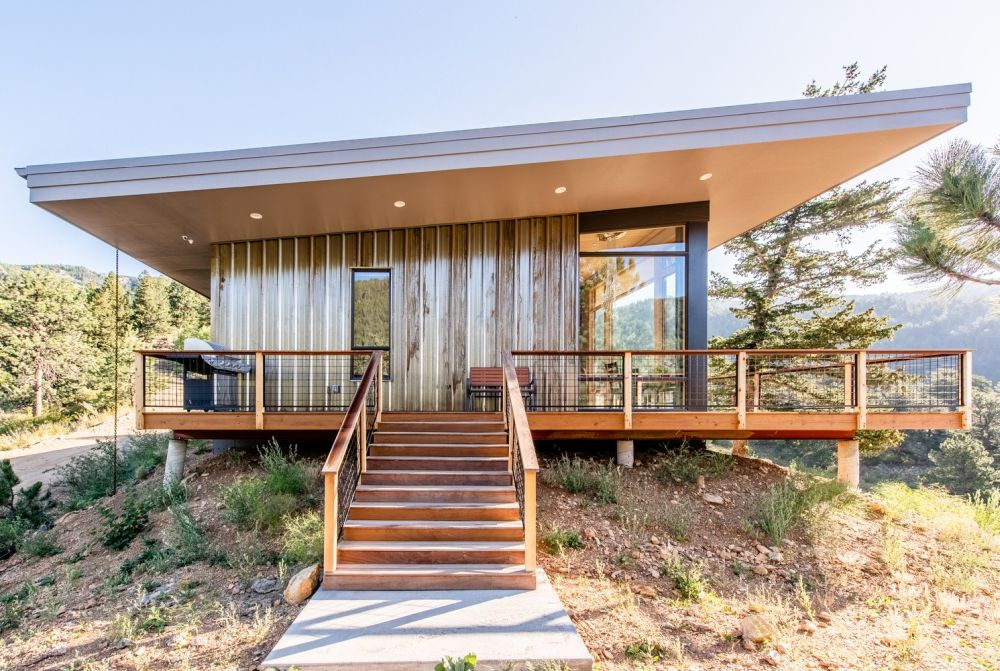 The house has a simple and clean geometry and a modern overall design