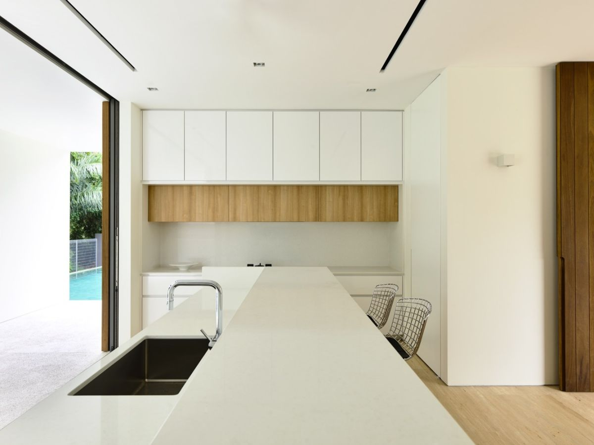The kitchen has a very interesting design as well, including a multipurpose island