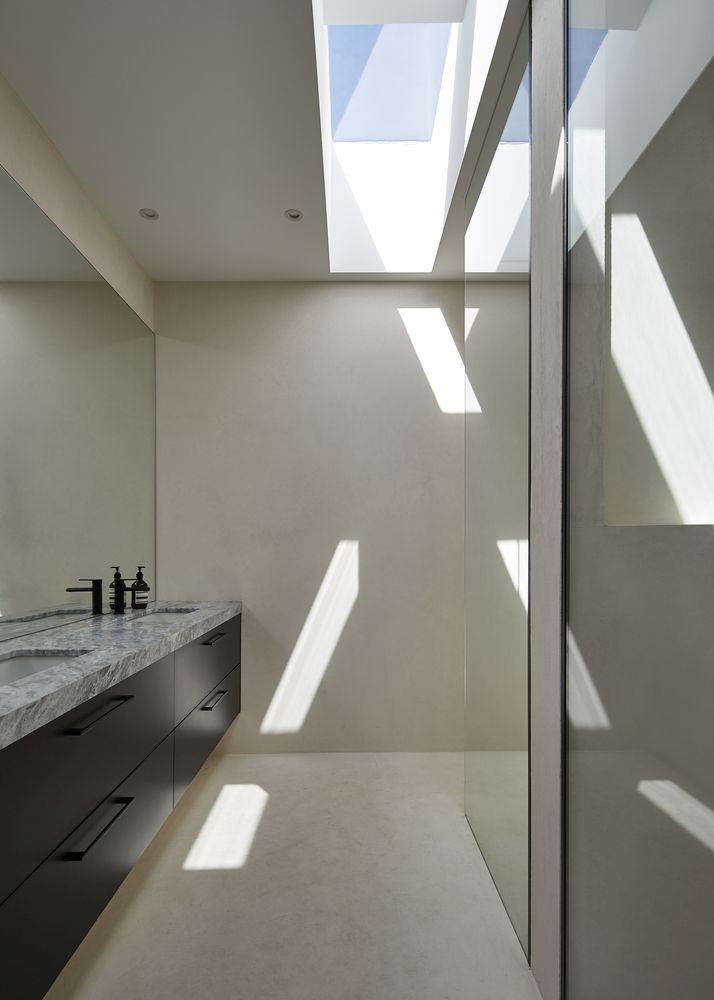 The bathrooms have large skylights which flood them with natural light from above