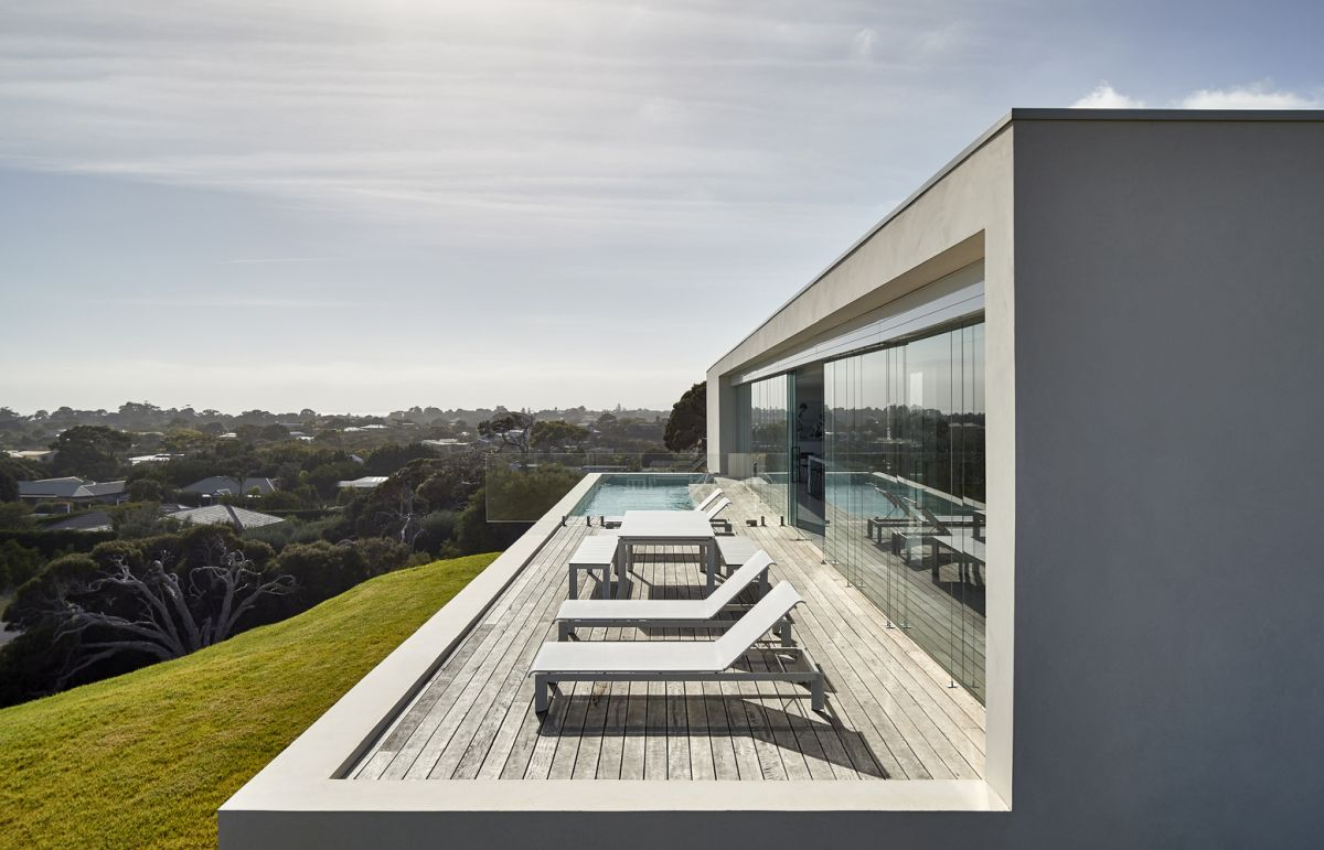 The open deck and the living areas inside have a panoramic view of the valley