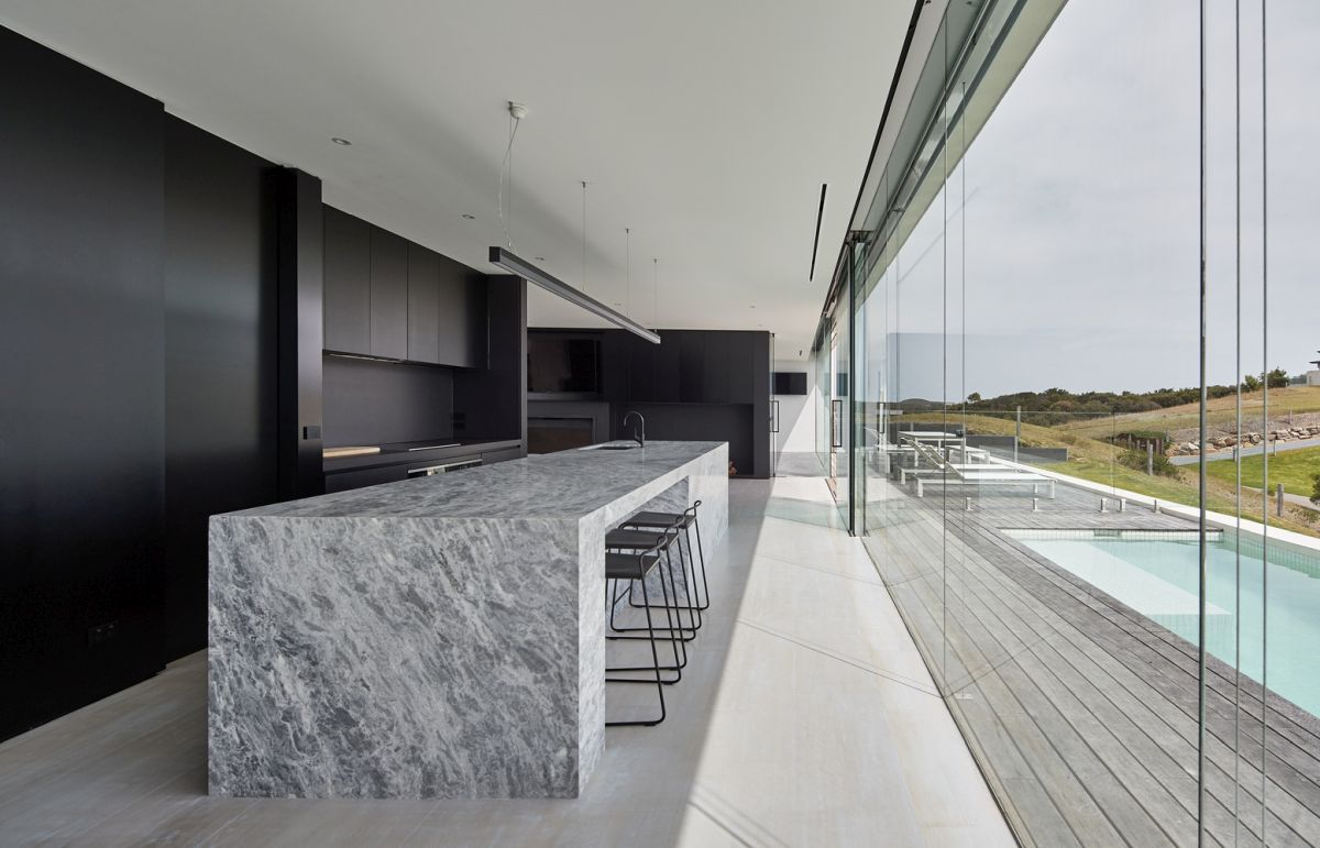 The centerpiece of the kitchen is a large limestone island placed at the center