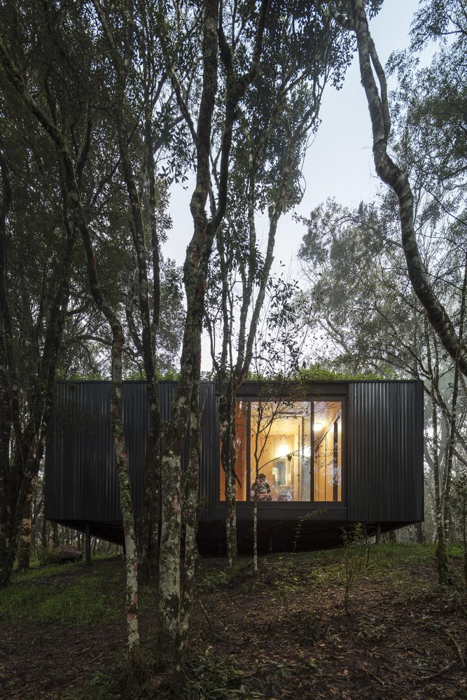Large windows allow views over the beautiful valley and the magnificent forest landscape