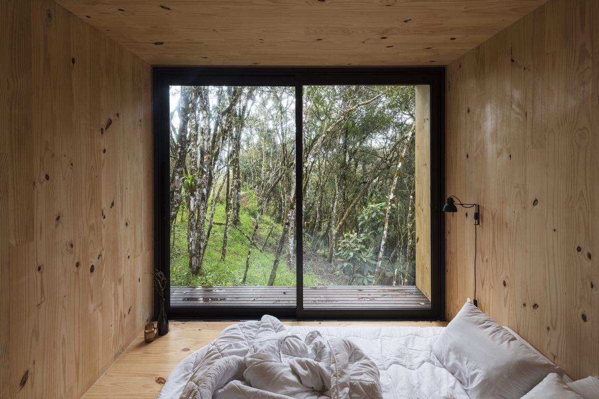 A sliding glass door provides direct access outside from the bedroom section