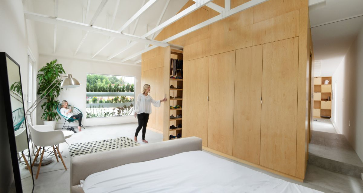 This large wooden unit houses most of the storage areas, the plumbing and the entrance to the bathroom