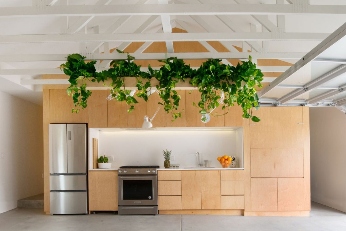 The exposed wooden trusses are painted white to match the walls and ceiling and occasionally decorated with greenery