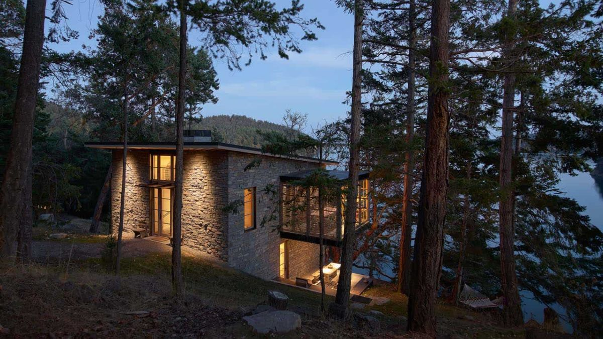The stone exterior helps the houses look natural within the rugged landscape