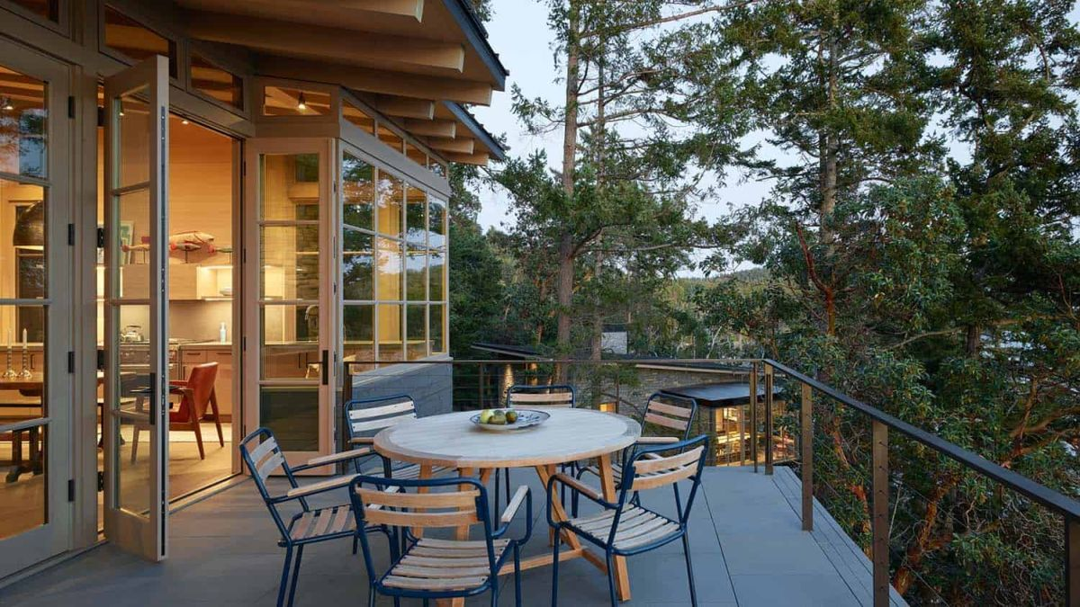 The social area opens onto a deck which sits among the tree canopies