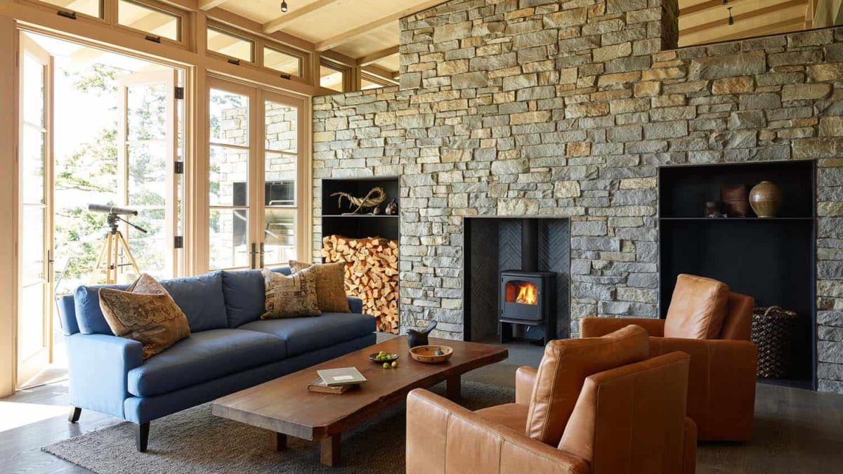 A large stone fireplace which extends over an entire wall is the focal point of the living room