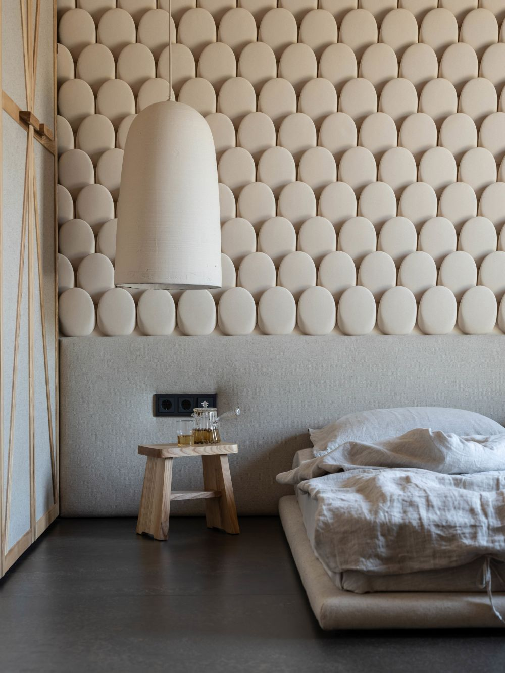 The master bedroom has a magnificent accent wall decorated with ceramic tiles