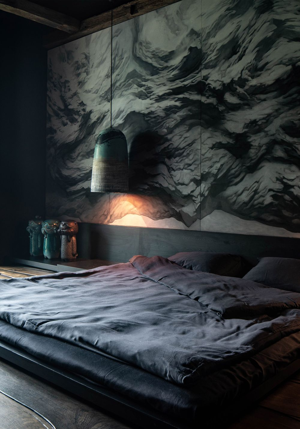 Each bedroom has a unique design. This one features wallpaper designed by the architect himself