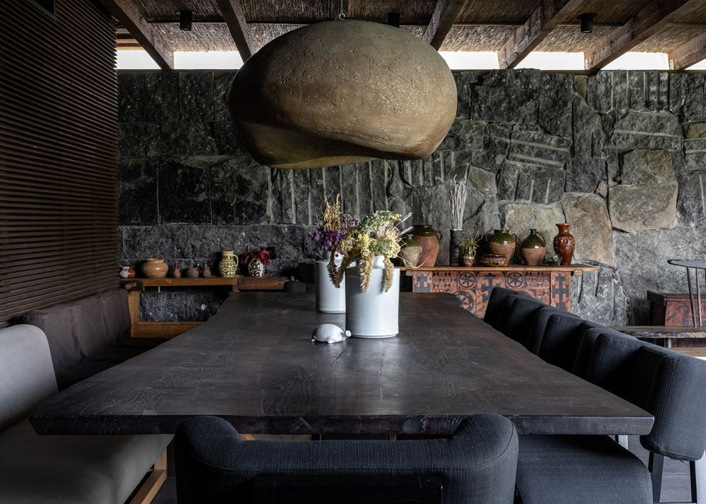Oversized pendant lamps serve as focal points in the social areas