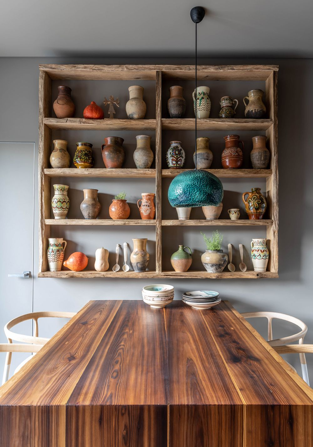The shelves that hold this amazing collection of ceramics are made of salvaged wood from abandoned structures