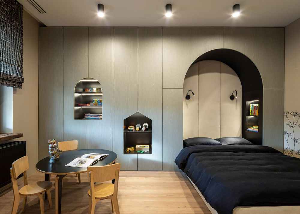 In this bedroom the walls are hand-painted with depictions of birds and vegetation