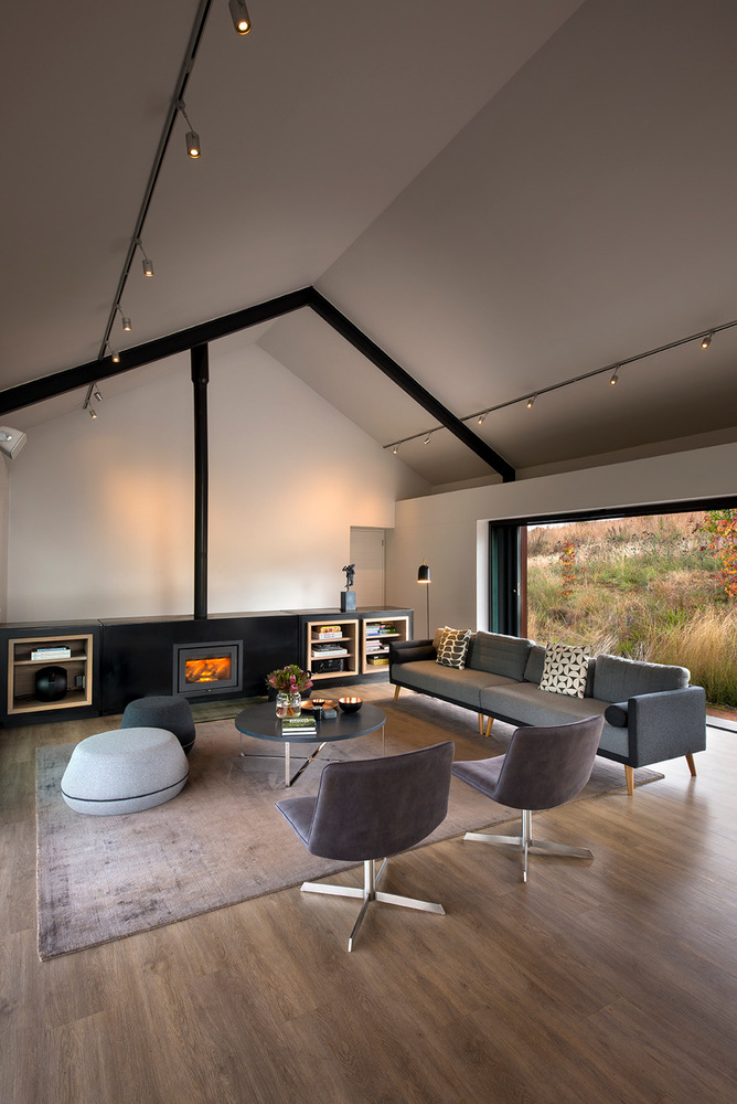The colors featured throughout the house are warm, earthy and simple