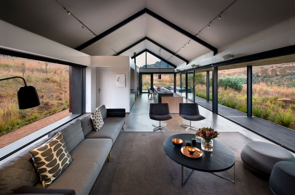 The common areas are all connected and form this open-plan volume framed by gorgeous views