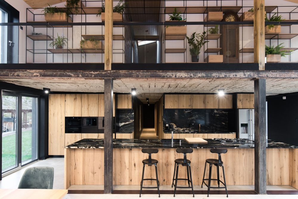 The raw concrete, exposed bricks and steel are complemented by lots of warm wood and polished finishes