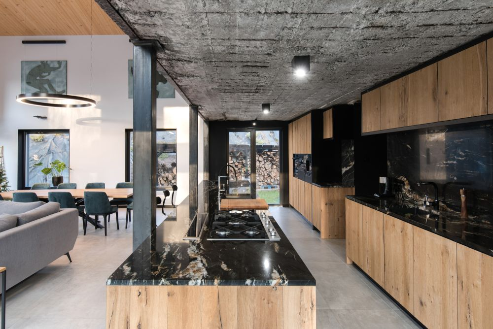 Raw concrete surfaces, exposed steel and bricks highlight the old sections of the building