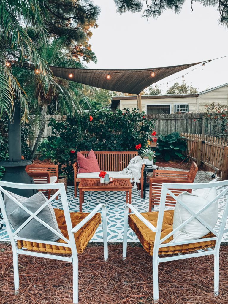 The vegetation complements the patio, giving it a cozy and refreshing look