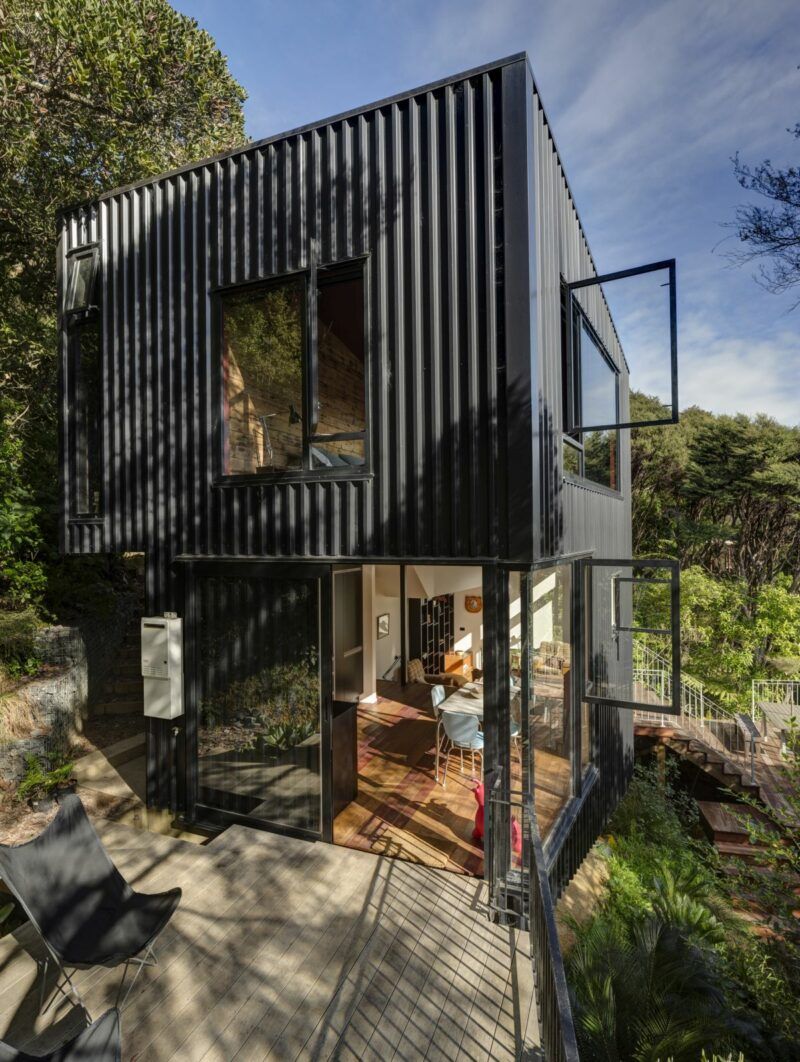 A Black House With A Tower-Like Design In The Canopies of New Zealand