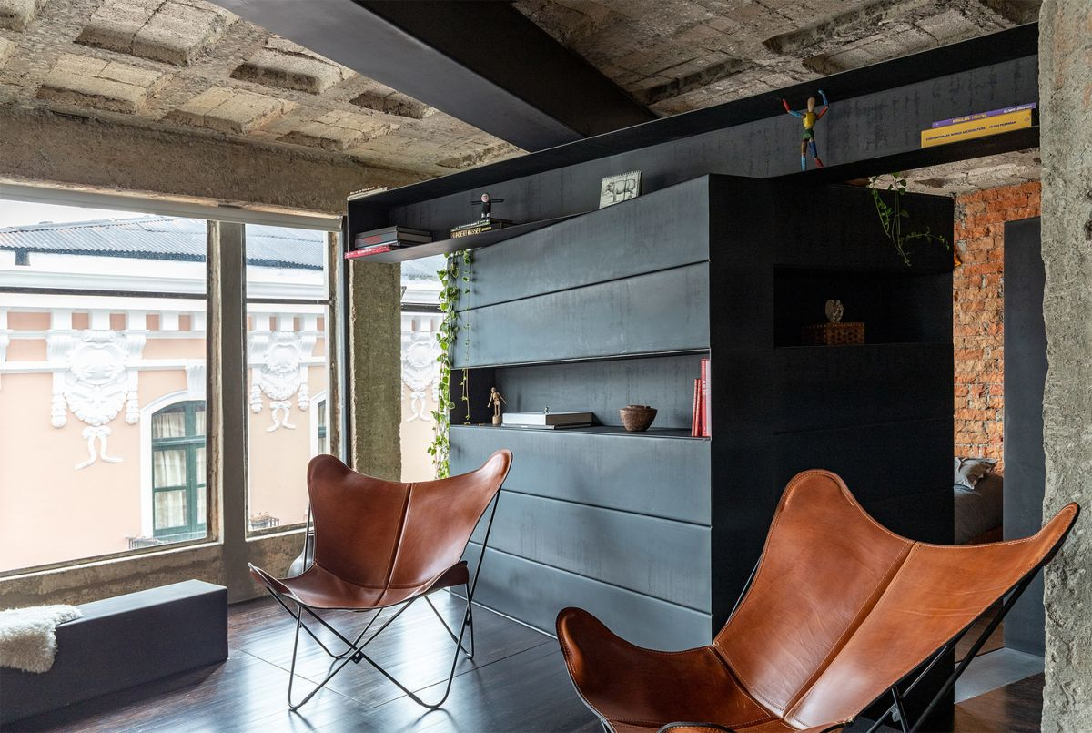 Bosque Apartment Intervention with unfinished design by Aquiles Jarrín leather seats - Freshly Remodeled Apartment Embraces An Open Layout With An Indoor Garden
