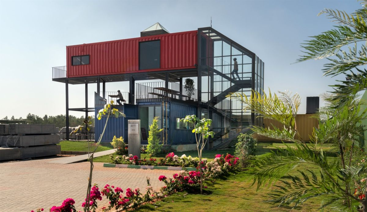 The tops of the blue containers form a large open deck which can be used for a variety of purposes
