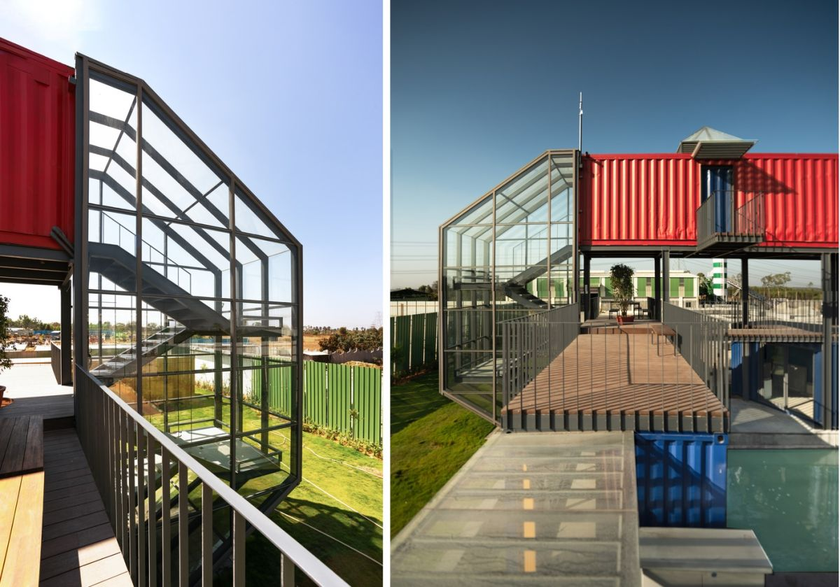The staircase is encased in a metal and glass frame with a strong modern-industrial look