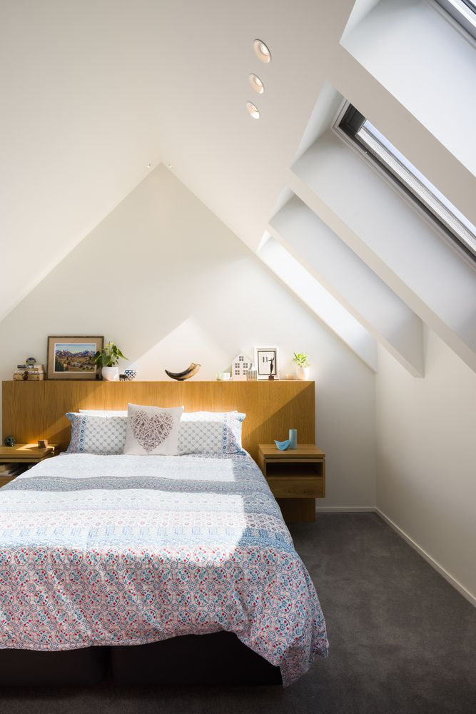 The upstairs bedroom is small and modest, making use of skylights to gain exposure to the natural light