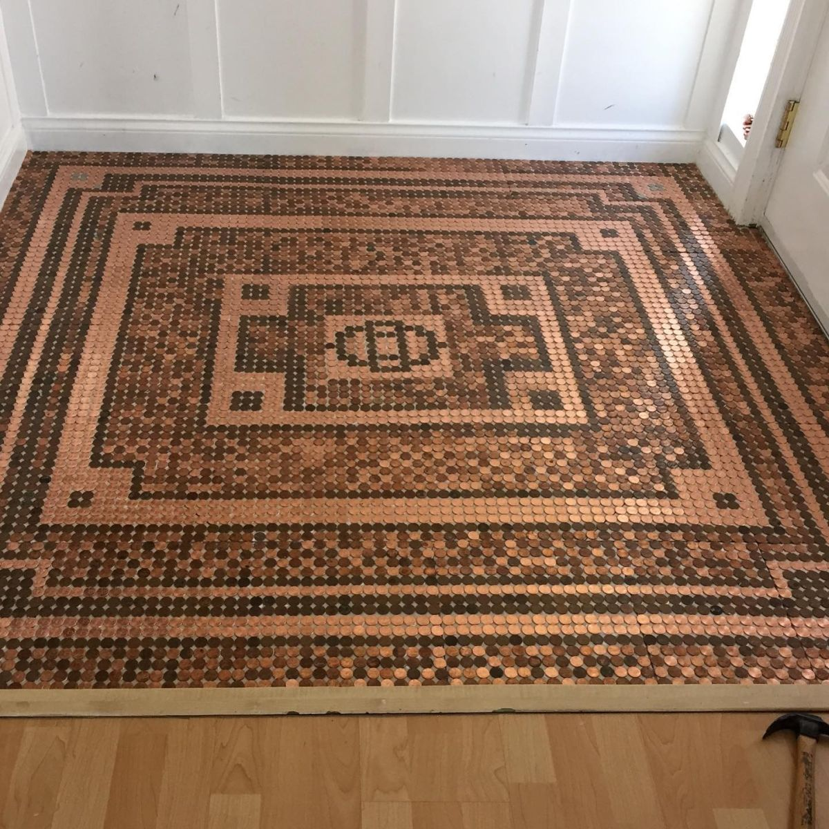 It took 7,500 pennies to cover up this floor area which measures around 6 square feet