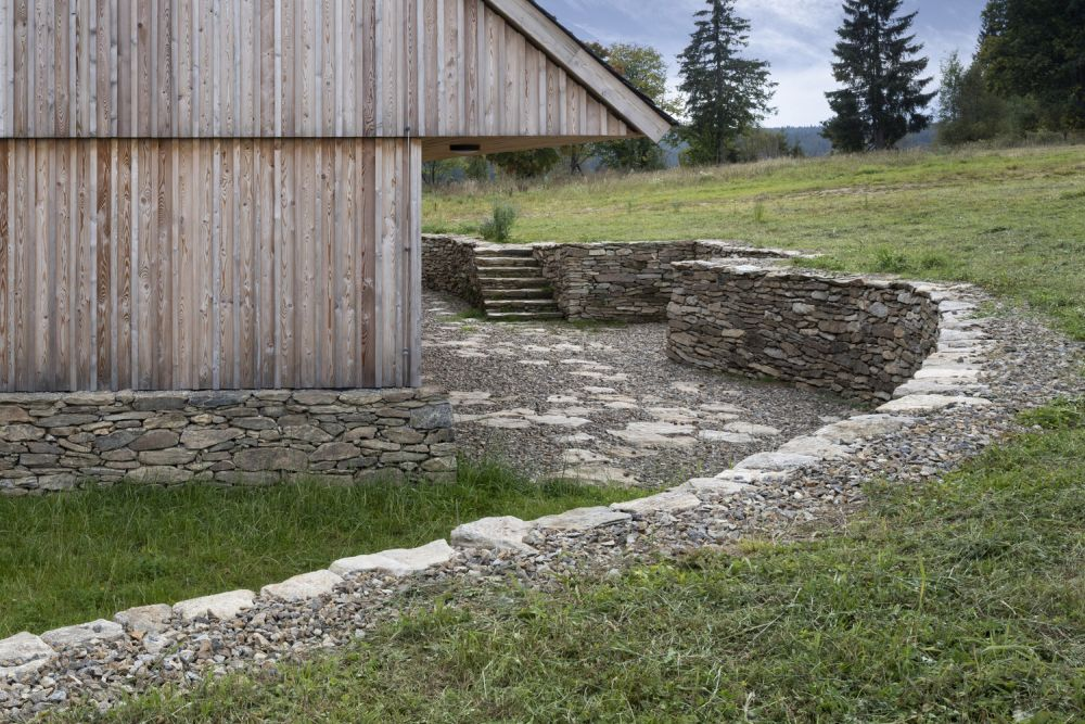 The chalet has a granite base and fits seamlessly into the area, showing great respect for the surrounding landscape