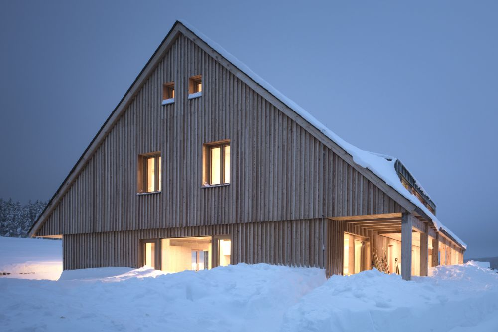 The wood-clad exterior gives the chalet a warm and inviting look even when it's surrounded by snow