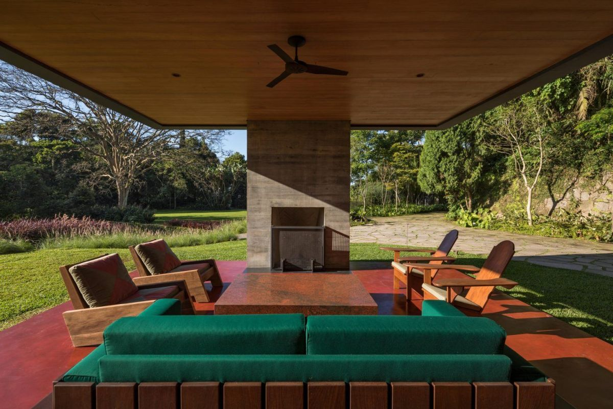 The fireplace is built into one of the concrete supports and completed this cozy sitting area
