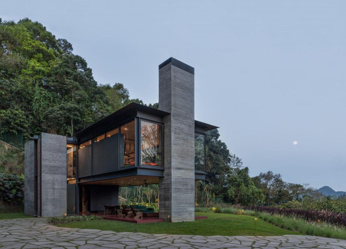 The interior section of the house is raised on top of concrete supports which maximizes the views