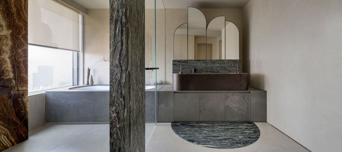 Although simple and with a subdued palette of finishes and colors, the bathroom is also elegant and has lots of character