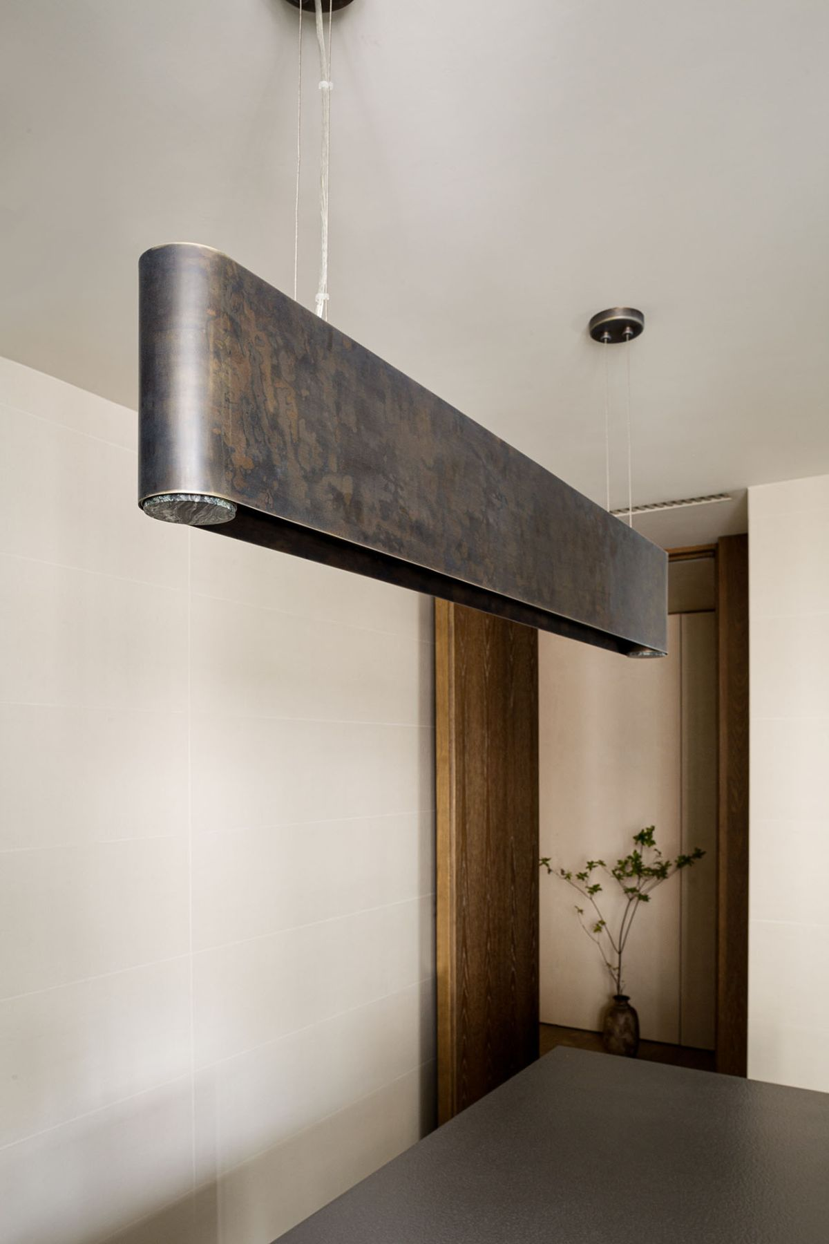 Oxidized metal accents and brass details have been seamlessly integrated into every room's decor