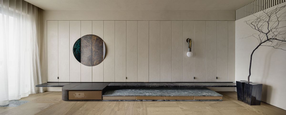 The living room has an entire wall covered in folding panels inspired by traditional Japanese shoji screens