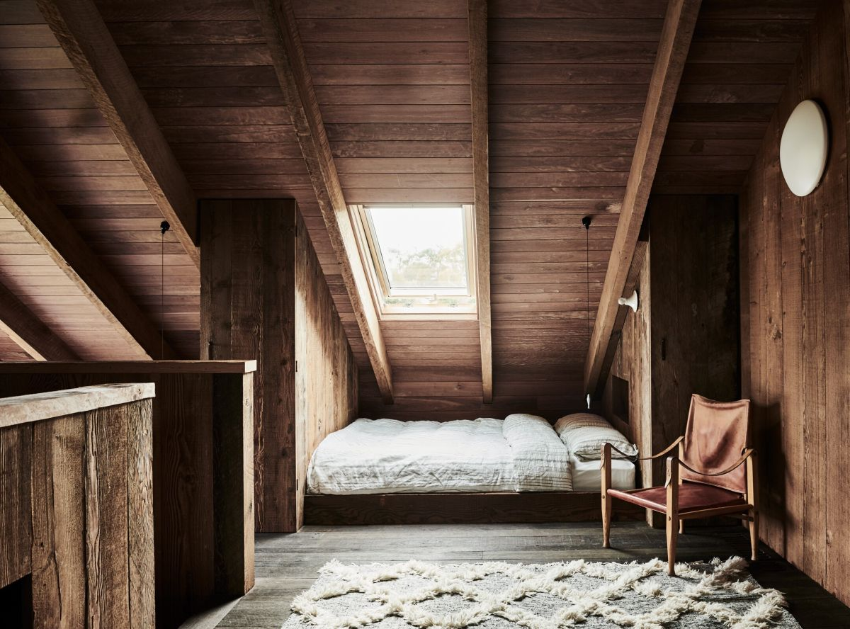The upstairs bedroom area has a very cozy attic-like feeling due to the slanted ceiling