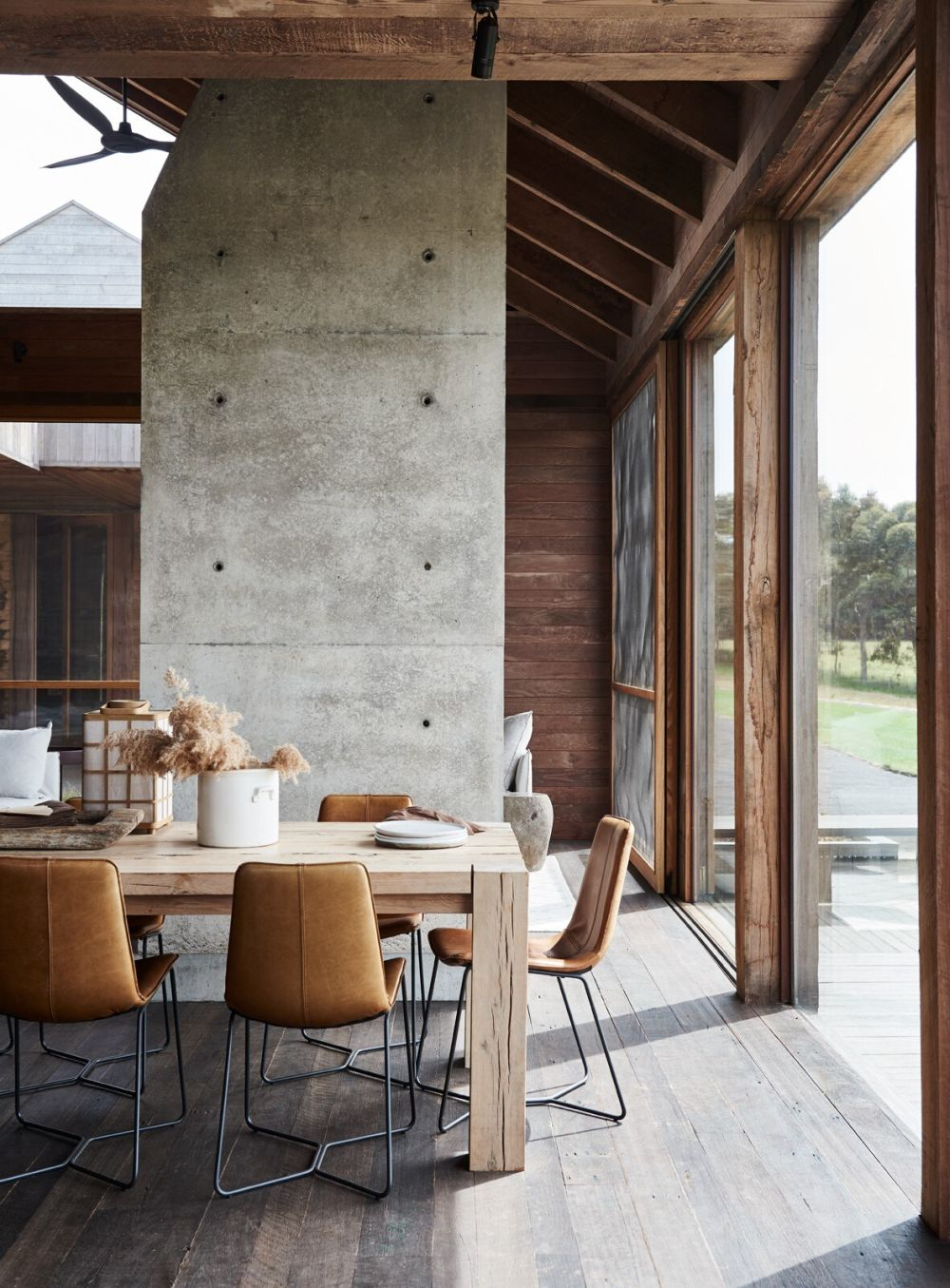 A concrete divider separates the sitting area from the rest of the floor plan