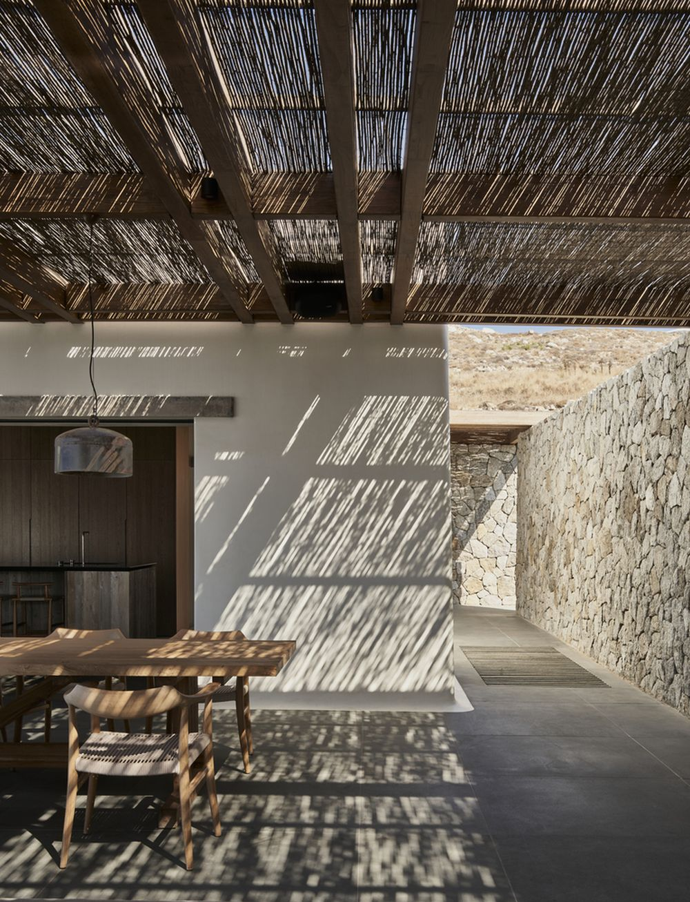 The courtyard is the central meeting point between all three volumes and has a traditional pergola