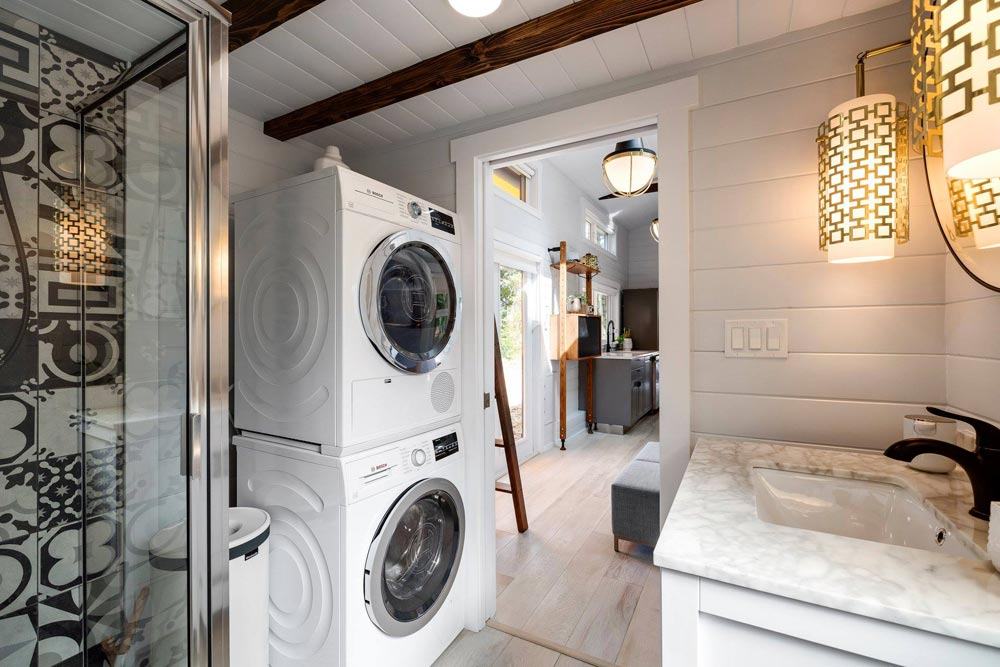 In the bathroom there's a shower, a vanity, toilet and also space for stackable washer and dryer