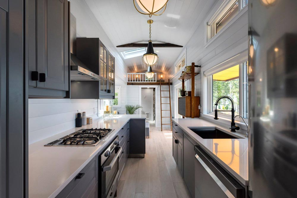The quartz countertops and the gray cabinets complement each other beautifully, giving the kitchen a modern look