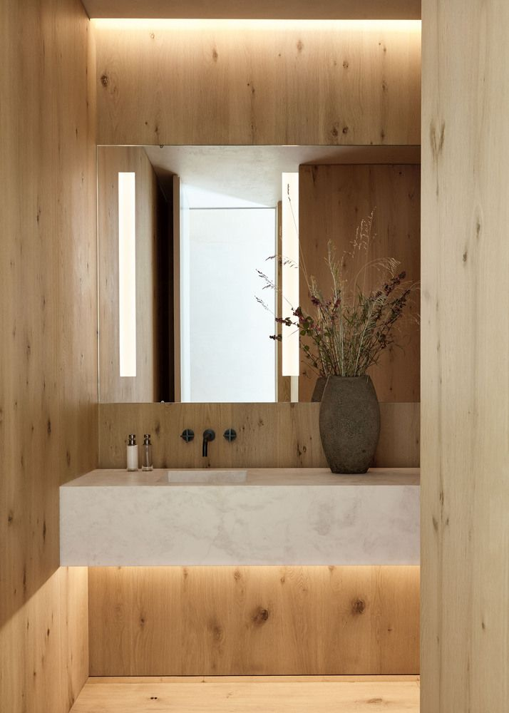 Natural wood and marble combined with soothing ambient lighting create a very zen ambiance in the bathroom