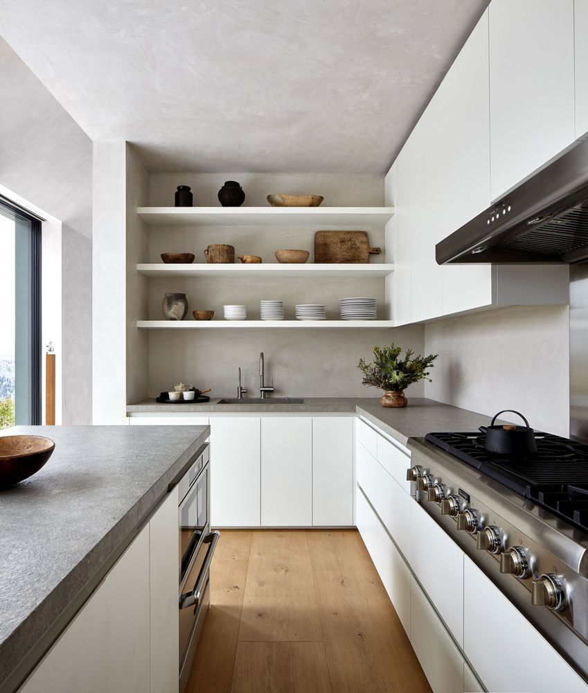 The kitchen is not exceptionally big but it maintains a very airy and chic look